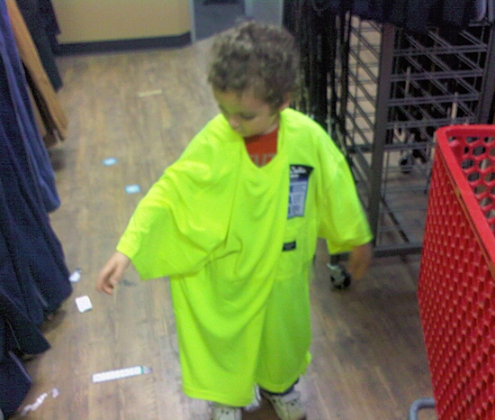 Boy trying on construction shirt