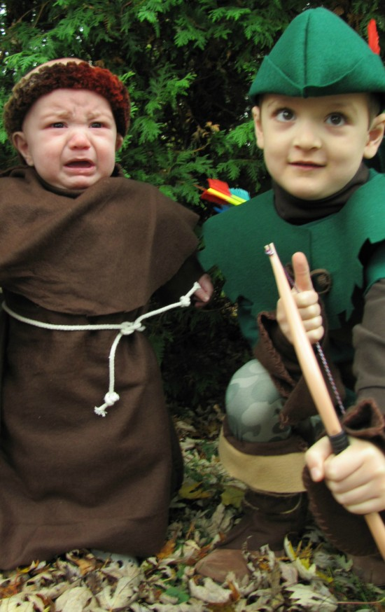 Unhappy baby in costume