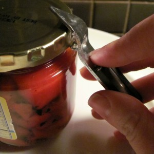 Use a bottle opener to pry open a stuck jar top
