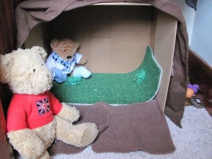 Cardboard box teddy bear den