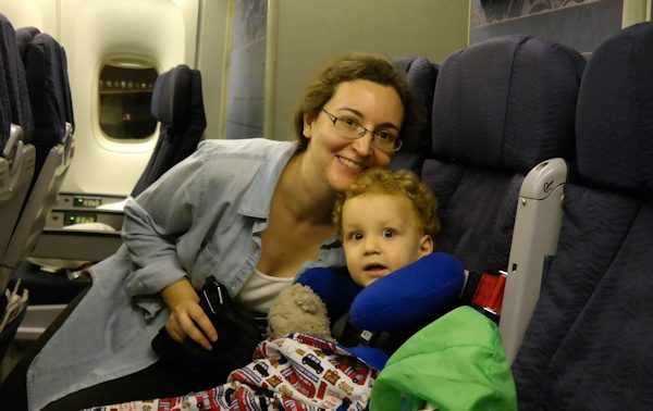 Mom and toddler on an international flight